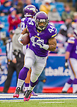 19 October 2014: Minnesota Vikings running back Matt Asiata warms up prior to facing the Buffalo Bills at Ralph Wilson Stadium in Orchard Park, NY. The Bills defeated the Vikings 17-16 in a dramatic, last minute, comeback touchdown drive. Mandatory Credit: Ed Wolfstein Photo *** RAW (NEF) Image File Available ***