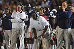 Ole Miss head coach Houston Nutt (left), and coaches Tyrone Nix (center) and Keith Burns vs. Alabama at Vaught-Hemingway Stadium in Oxford, Miss. on Saturday, October 14, 2011. Alabama won 52-7.