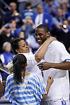 UK's Darius Miller celebrates senior day with his family before playing Georgia at Rupp Arena on Friday, March 2, 2012. Photo by Scott Hannigan | Staff