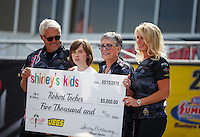 May 15, 2016; Commerce, GA, USA; NHRA former top fuel driver Shirley Muldowney presents a check to Robert Tocher on behalf of her Shirleys Kids foundation during the Southern Nationals at Atlanta Dragway. Mandatory Credit: Mark J. Rebilas-USA TODAY Sports