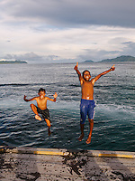 Local children play at the pier of Arborek, a small island in Raja Ampat archipelago, Indonesia.