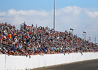 Feb 26, 2017; Chandler, AZ, USA; Overall view of fans in the grandstands of Wild Horse Pass Motorsports Park during the NHRA Arizona Nationals. Mandatory Credit: Mark J. Rebilas-USA TODAY Sports
