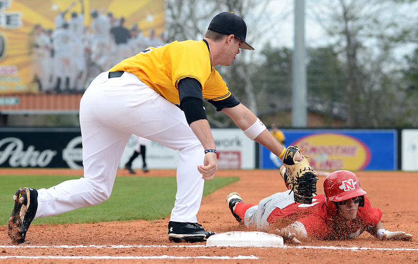 Nicholls State's Matt Richard (4) jumps back to first base as USM first baseman Blake Brown (22) attempts to tag him out on Sunday afternoon during their game at Pete Taylor Field. Bryant Hawkins/ Hattiesburg American