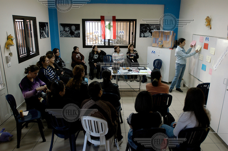 Iraqi refugee women attend a course about domestic violence, children's education and an English class given by the United Nations High Commissioner for Refugees (UNHCR) and the International Medical Corps at the Centre Social des Soeurs du Bon Pateur in Roueissat, East Beirut. Lebanon is host to an estimated 50,000 Iraqi refugees.