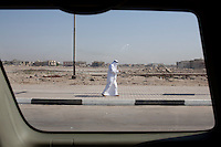 A man walks down the street on Friday, October 22, 2010 in Basrah, Iraq.