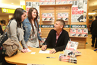 NO REPRO FEE. 8/10/2011.Eason, Ireland's leading retailer of books, stationery, magazines and lots more, hosted a book signing by comedian Des Bishop. Pictured at Eason O'Connell Street, Dublin are fans Nicole Kinsela 17 and Rachel Byrne 17 from Clondalkin and Des Bishop who signed copies of his new book My Dad was nearly James Bond. Follow Eason on Twitter - @easons For further information, please contact: Aoife McDonald WHPR 087 4100777 Picture James Horan/Collins Photos