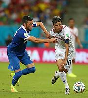 Vasileios Torosidis of Greece and Bryan Ruiz of Costa Rica in action