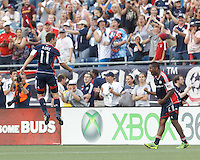 New England Revolution substitute midfielder Kelyn Rowe (11) leaps and celebrates his goal with teammates.  In a Major League Soccer (MLS) match, the New England Revolution (blue) defeated LA Galaxy (white), 5-0, at Gillette Stadium on June 2, 2013.