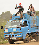 Landfill, Kampala, Uganda..Middle-men in trucks drive into municipal dump in Kampala, Uganda to collect plastic, tin and other materials for recycling.