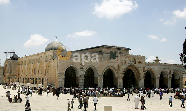 Palestinian Muslim worshippers sit in front of Al-Aqsa mosque during Friday prayers in the Al Aqsa Mosque compound, also known to Jews as the Temple Mount, in Jerusalem's old city on May 28, 2010. Photo by Mahfouz Abu Turk