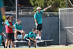 02 September 2013: Coastal Carolina head coach Shaun Docking stands on the bench to get a better view of the field. The University of North Carolina Tar Heels hosted the Coastal Carolina University Chanticleers at Fetzer Field in Chapel Hill, NC in a 2013 NCAA Division I Men's Soccer match. UNC won the game 4-0.