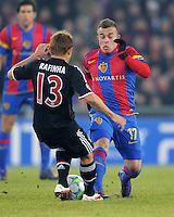 FUSSBALL  CHAMPIONS LEAGUE  SAISON 2011/2012 Achtelfinale Hinspiel  22.02.2012 FC Basel - FC Bayern Muenchen  Rafinha (li, FC Bayern Muenchen) gegen Xherdan Shaqiri (re, FC Basel)