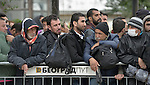 Men await entry to a refugee processing center in the Serbian village of Presevo, not far from the Macedonian border. Hundreds of thousands of refugees and migrants have flowed through Serbia in 2015, on their way from Syria, Iraq and other countries to western Europe.