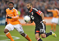 D.C. United forward Maicon Santos (29) goes against Houston Dynamo defender Jermaine Taylor (4) D.C. United tied The Houston Dynamo 1-1 but lost in the overall score 4-2 in the second leg of the Eastern Conference Championship at RFK Stadium, Sunday November 18, 2012.
