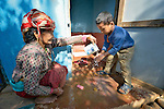 Pamfa Maya Pulami helps a boy wash his hands after using a latrine in Salang, a village in the Dhading District of Nepal where Dan Church Aid, a member of the ACT Alliance, has provided a variety of support to local villagers in the wake of a devastating 2015 earthquake. The village's water system was destroyed by the quake, forcing women to walk two hours or more to a nearby river to fetch water. Working with a local organization, the Forum for Awareness and Youth Activity, the ACT Alliance rebuilt the village's water system and installed new latrines for residents.