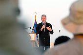 Former United States President Bill Clinton speaks to airmen at a deployed location January 12, 2004.  The former president spent more than one hour shaking hands, signing mementos and posing for photographs during his visit. <br /> Mandatory Credit: Lynne Neveu / USAF via CNP