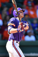 Left fielder Seth Beer (28) of the Clemson Tigers watches his first-inning home run sail over the right field fence in the Reedy River Rivalry game against the South Carolina Gamecocks  on Saturday, March 4, 2017, at Fluor Field at the West End in Greenville, South Carolina. Clemson won, 8-7. (Tom Priddy/Four Seam Images)