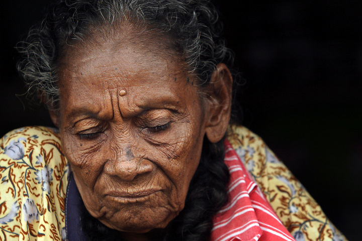 NUQUÍ, EL CHOCO, COLOMBIA -- DECEMBER:  An old woman in Nuqui on December 12, 2005. Nuquí is a small town on Colombia's isolated and untamed Pacific coast, an area sandwiched between endless miles of trackless rainforest and the Pacific Ocean. (Photo by Dennis Drenner/Aurora).