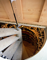 A concealed trap door opened to reveal a curved staircase leading down to a wine cellar
