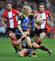 Tom Biggs is tackled in possession. J.P. Morgan Premiership Rugby 7s match, between London Welsh and Bath Rugby on August 3, 2012 at the Recreation Ground in Bath, England. Photo by: Patrick Khachfe / Onside Images