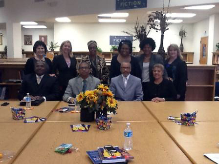 Team HISD and members of the Houston Branch of the NAACP discuss HISD's literacy initiative at B.K. Bruce Elementary School.