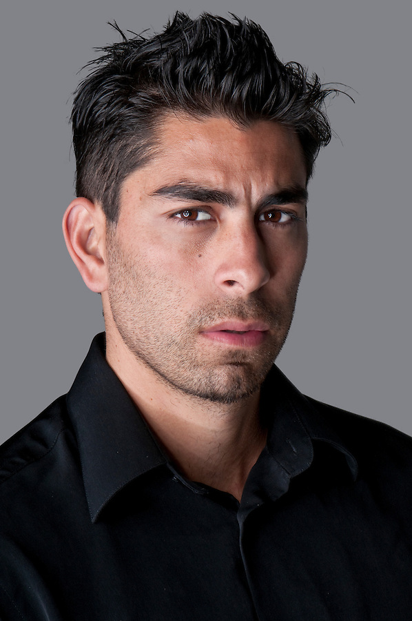 Portrait of young attractive hispanic man.