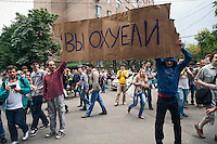 17/08/2012, Moscow, Russia..Protesters wave a banner reading ?You're pricks? at the court building as Maria Alyokhina, Yekaterina Samutsevich and Nadezhda Tolokonnikova of punk band Pussy Riot are sentenced to two years prison for their performance in the Christ The Saviour Cathedral.