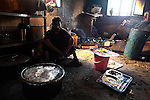 A cook sits in his kitchen at a police station in Kandahar, Afghanistan. Oct. 17, 2010. DREW BROWN/STARS AND STRIPES