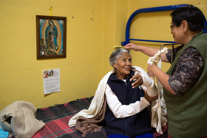 Elia, a resident of Casa Xochiquetzal, brushing Josée's hair at the shelter in Mexico City, Mexico on February 10, 2017. Casa Xochiquetzal is a shelter for elderly sex workers in Mexico City. It gives the women refuge, food, health services, a space to learn about their human rights and courses to help them rediscover their self-confidence and deal with traumatic aspects of their lives. Casa Xochiquetzal provides a space to age with dignity for a group of vulnerable women who are often invisible to society at large. It is the only such shelter existing in Latin America. Photo by Bénédicte Desrus