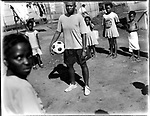 Aretha Tshabalala (20), with local kids, Kwa-xuma Township, Soweto, South Africa, 1998