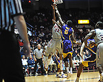"Ole Miss' Jarvis Summers (32) vs. LSU's Malcolm White (5) at the C.M. ""Tad"" Smith Coliseum in Oxford, Miss. on Saturday, February 25, 2012. (AP Photo/Oxford Eagle, Bruce Newman)..."
