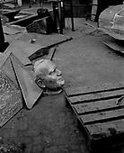 Rzaska, March 1, 2011:.Bronze head of pope John Paul 2  by Czeslaw Dzwigaj waiting to be welded to the body, at the welding workshop.. (Photo by Piotr Malecki / Napo Images)..Rzaska, 1/03/2011: .Glowa pomnika papieza Jana Pawla II autorstwa Czeslawa Dzwigaja w pracowni spawalniczej..Fot: Piotr Malecki / Napo Images.