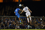 06 December 2014: North Carolina's Andy Craven (10) and UCLA's Aaron Simmons (5) challenge for a header. The University of California Los Angeles Bruins hosted the University of North Carolina Tar Heels at Drake Stadium in Los Angeles, California in a 2014 NCAA Division I Men's Soccer Tournament Quarterfinal round match. The game ended in a 3-3 tie after two overtimes. UCLA advanced to the next round by winning the penalty kick shootout 7-6.
