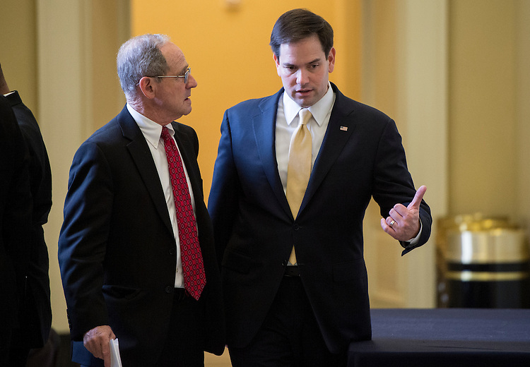 UNITED STATES - APRIL 14: Sen. Jim Risch, R-Idaho, left, speaks with Sen. Marco Rubio, R-Fla., outside of the Senate Republicans' policy lunch in the Capitol on Tuesday, April 14, 2015. (Photo By Bill Clark/CQ Roll Call)
