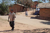 "A Community Police walks in the streets in El ParaÌso, in Ayutla de los Libres, na¥savi (mixteco) indigenous community. El ParaÌso is the newest headquarter of the Community Police (founded in 2012) and its the main flashpoint with other armed groups such as the self-called ""Autodefensas"" (Self-Defenses) and paramilitary groups. / Un policÌa comunitario camina en las callesdel pueblo El ParaÌso, en Ayutla de los Libres, comunidad indÌgena na'savi o mixteco. El ParaÌso es la sede m·s reciente de la PolicÌa Comunitaria (fundado en 2012) y es el principal lugar de confrontaciÛn con otros grupos armados como los conocidos como Autodefensas y grupos paramilitares.  (Photo: Prometeo Lucero)"