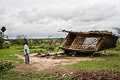 A villager is seen next to a devasted hut that was hit by cyclone Nargis in Thanlyin area, 70 kms east of the capital Yangon. No help has reached for these villagers in days.