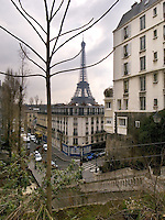 France. Paris. Eiffel tower. Spring time and grey weather. tree with no leaves. 15.03.09 &copy; 2009 Didier Ruef