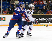 Martin Marincin (Slovakia - 25), Kyle Palmieri (USA - 23) - Team USA defeated Team Slovakia 7-3 on Saturday, December 26, 2009, at the Credit Union Centre in Saskatoon, Saskatchewan during the 2010 World Juniors tournament.