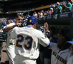Seattle Mariners' greet Nelson Cruz (23) after he hit a home run against the Texas Rangers'  in the first inning at SAFECO Field in Seattle on April 10, 2015.  The Mariners came from behind to beat the Rangers 11-10.  Jim Bryant Photo. ©2015. All Rights Reserved.
