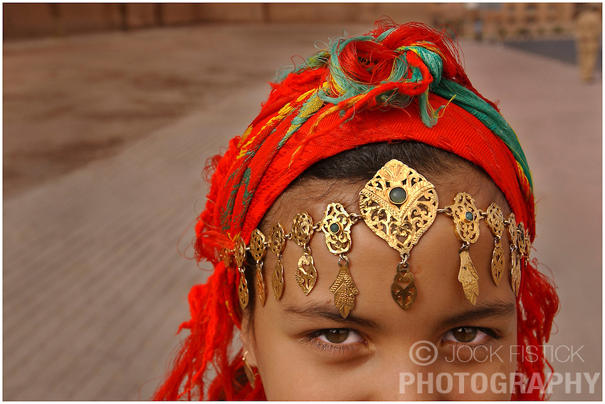 MOROCCO - OCT-7-2004 - A young girl wears traditional Moroccan clothes