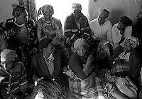 A group of mothers prepare to examine 60 young girls for virginity in Magqabasini village, near Flagstaff in the former Transkei July 20, 1999.  This tradition has been revived to combat child abuse and high rates of teenage pregnancies and the spread of HIV. Mavis Ntingandi is second from left, front, in beret. (Greg Marinovich)
