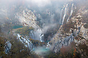 Veliki Slap (The Big Waterfall - back right) and a series of waterfalls known as 'Sastavci' that cascade between mountain lakes, Plitvice Lakes National Park, Croatia. November.