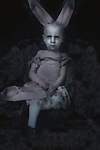 Conceptual image of female child wearing rabbit ears and dress
