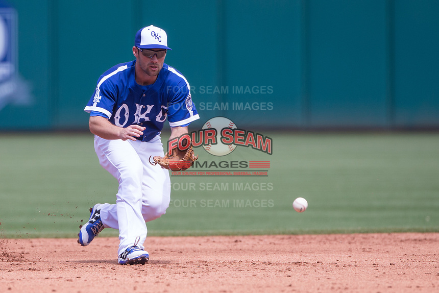 Charlie Culberson (6) of the Oklahoma City Dodger goes after a hit ball during a game against the Iowa Cubs at Chickasaw Bricktown Ballpark on April 9, 2016 in Oklahoma City, Oklahoma.  Oklahoma City defeated Iowa 12-1 (William Purnell/Four Seam Images)