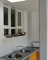 Though compact, there is space in this urban kitchen for a double sink