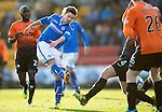St Johnstone v Dundee United.....29.12.13   SPFL<br /> Gwion Edwards shot is blocked by Calum Butcher<br /> Picture by Graeme Hart.<br /> Copyright Perthshire Picture Agency<br /> Tel: 01738 623350  Mobile: 07990 594431