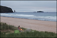BNPS.co.uk (01202 558833)<br /> Pic: WildGuideScotland/BNPS<br /> <br /> Sandwood Bay on the north west tip of remote Sutherland.<br /> <br /> Scotland's stunning unspoiled scenery is being shown in a whole new light in a book that reveals the hidden gems off the beaten track north of the border.<br /> <br /> Three young photographers travelled the width and breadth of Scotland and snapped 750 picturesque places which include shimmering lochs, ancient forests, lost ruins, hidden beaches, secret islands, dramatic cliffs, tiny glens and mysterious grottoes. <br /> <br /> Friends Kimberley Grant, David Cooper and Richard Gaston, all in their late 20s, have spent the past two years exploring lesser known idyllic spots which they are keen to bring to a wider audience.