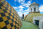Uniformed student provides rooftop tours of the checkered green and gold tiled domes of the Metropolitan Cathedral or La Catedral.  The Cathedral is located in the Centro Historico or Old Town, and has been declared a UNESCO World Cultural Heritage Site in Quito, Ecuador.