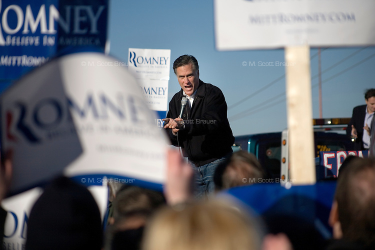 Republican presidential candidate Mitt Romney, former governor of Massachusetts, speaks to supporters and the media at a rally in Manchester, New Hampshire, on Sat. Dec. 3, 2011. The rally was called, &quot;Earn It with Mitt,&quot; and was designed to bolster local efforts to help Romney &quot;earn&quot; voters' support for the upcoming Republican primary.