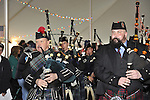 Fund raiser for firefighter Ray Pfeifer on Saturday, March 31, 2012, at East Meadow Firefighters Benevolent Hall, New York, USA.Tim McMaster (right) played bagpipes with Boston Gaelic Fire Brigade Pipes and Drums band.